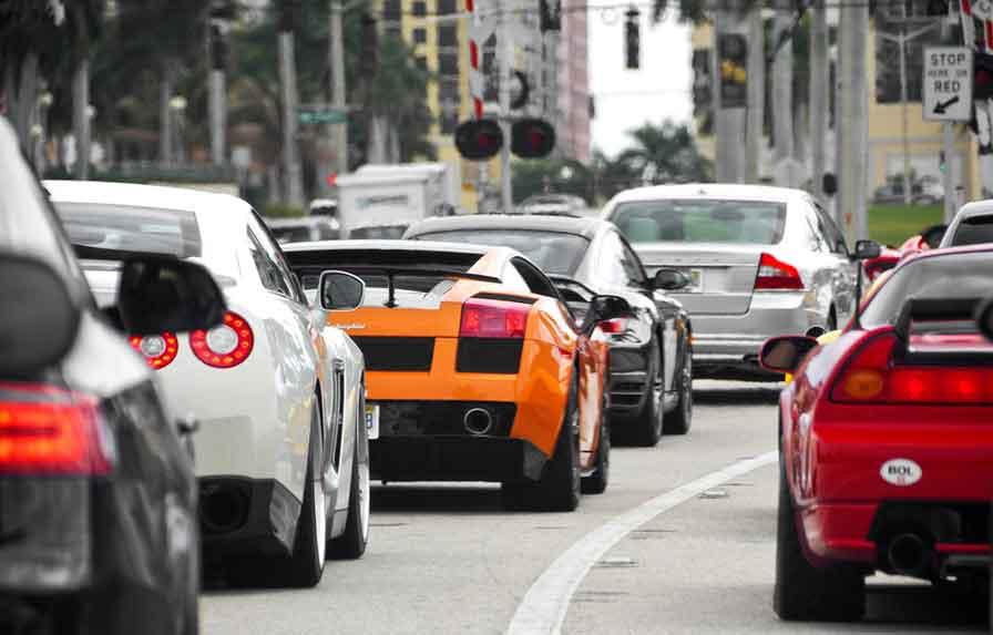 perception_speeding red sports car swerving behind an ambulance